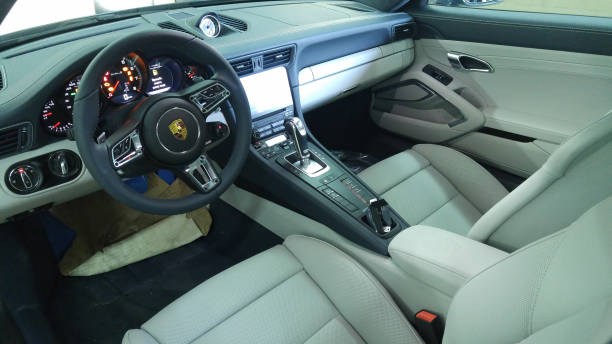 Porsche 911 991 Turbo Gray interior with pcm 4, analog clocks and keyless. Steering wheel with sport responce Moscow. February 2018. Porsche 911 991 Turbo Gray interior with pcm 4, analog clocks and keyless. Steering wheel with sport responce porsche stock pictures, royalty-free photos & images
