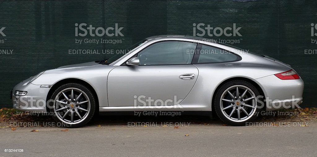 Porsche 911 carrera 4 Medvode, Slovenia - October 8, 2016: Private car, Porsche carrera 4s parked near local road in front of Goricane castle. 2015 Stock Photo