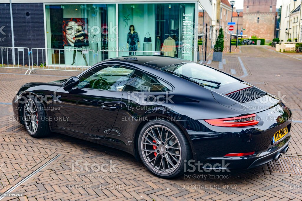 Porsche 911 CARRERA S parked on a city street stock photo