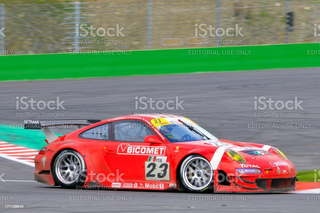 BMS Scuderia Italia Porsche 911 GT3 RSR race car racing through the...