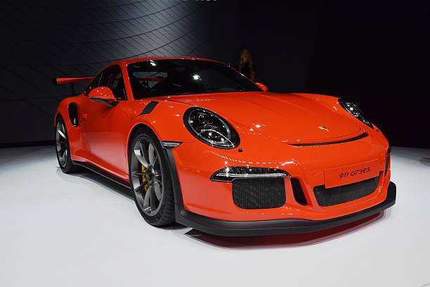 Porsche 911 GT3RS on the motor show Geneva, Switzerland - March, 3rd, 2015: The presentation of Porsche 911 GT3RS supercar on the motor show. This vehicle is the one of the fastest cars in the world. porsche stock pictures, royalty-free photos & images
