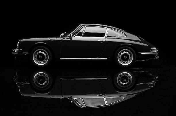 Porsche 911 Low Key In Black And White Beaconsfield, UK - October 7, 2015: A 1:18 scale model of a 1964 Porsche 911 made by Auto Art, set against a solid black background. Low key/black & white image. porsche stock pictures, royalty-free photos & images