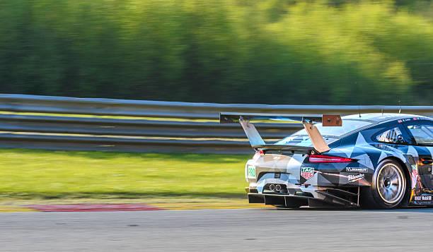 porsche 911 rsr dempsey proton racing - proton auto stock-fotos und bilder