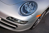 Orland Park, Illinois, USA - October 7, 2007: Left front end and headlight of a silver Porsche 911 German sportscar.