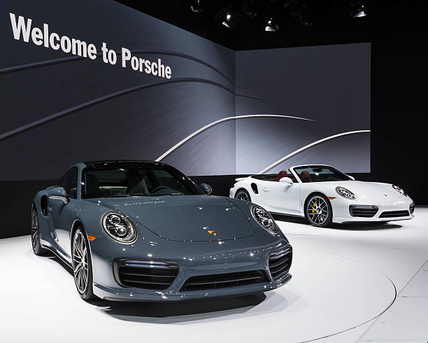 2017 Porsche 911 Turbo and Turbo S Detroit, MI, USA - January 12, 2016:  A 2017 Porsche 911 Turbo and Turbo S global debut car at the North American International Auto Show (NAIAS), one of the most influential car shows in the world each year. porsche stock pictures, royalty-free photos & images