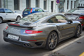 Moscow, Russia - July 10, 2016: Porsche 911 turbo parked on the street, back side view