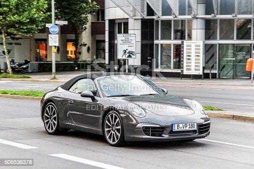 Berlin, Germany - September 12, 2013: Motor car Porsche 991 911 drives in the city street.