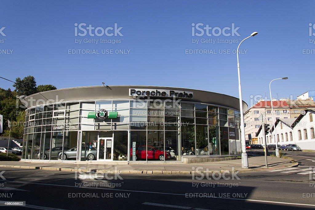 Porsche and Skoda auto logos on czech dealership building stock photo