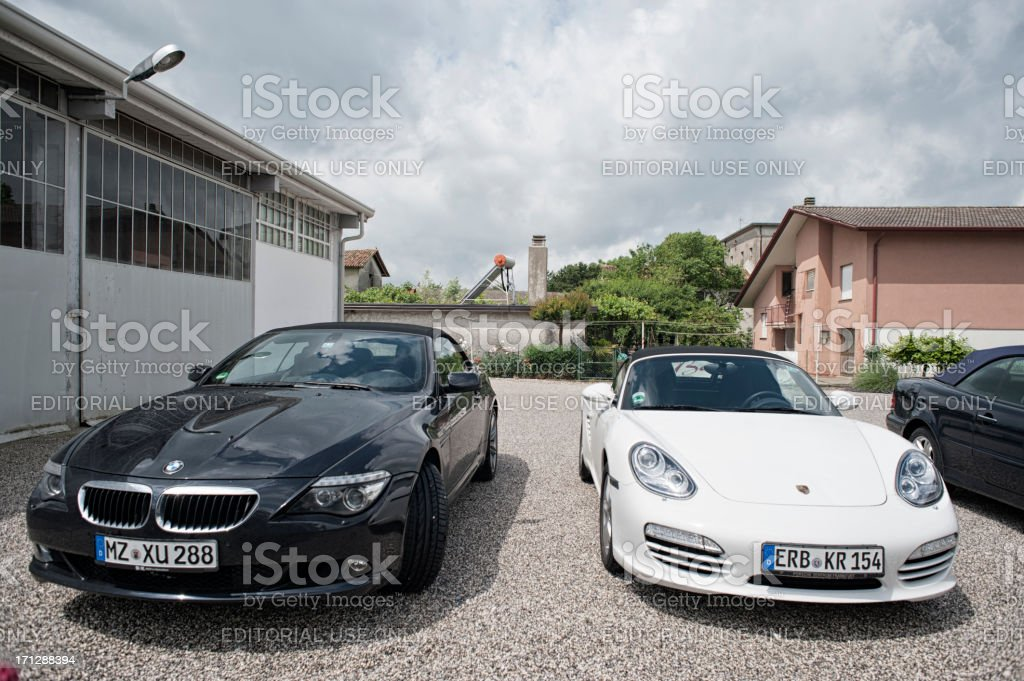 Porsche Boxster (Typ 981), BMW 630 Convertible royalty-free stock photo