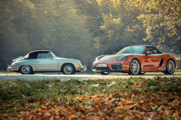 Porsche boxter classic versus New model Porsche boxter classic versus new model, colorful photo, red and silver car, classsic car and modern car in the same photo.Photo was made in Serbia with idea to compare same model of the car from past century and newer age. Photo was made in november 2015 and on the photo is very rare classic Porsche. Idea was to present design and concept from the past comparing to modern car today. Photographed outdoor. porsche stock pictures, royalty-free photos & images