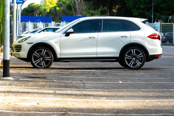 Porsche Cayenne car Rome, Italy - September 4, 2018: Porsche Cayenne car. Porsche AG is a German automobile manufacturer specializing in high-performance sports cars, SUVs and sedans status symbol stock pictures, royalty-free photos & images