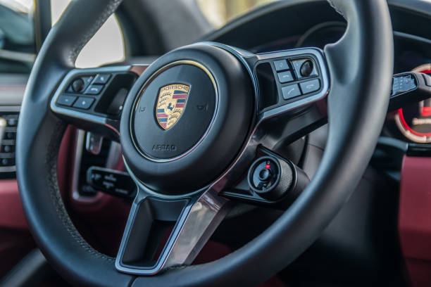 Porsche Cayenne S 2018. Steering wheel. Minsk, Belarus - June 9, 2018: Photo of multifunction sports steering wheel of Porsche Cayenne S 2018 (third generation) with gearshift paddles that enable sporty, fast, ergonomic shifing. porsche stock pictures, royalty-free photos & images
