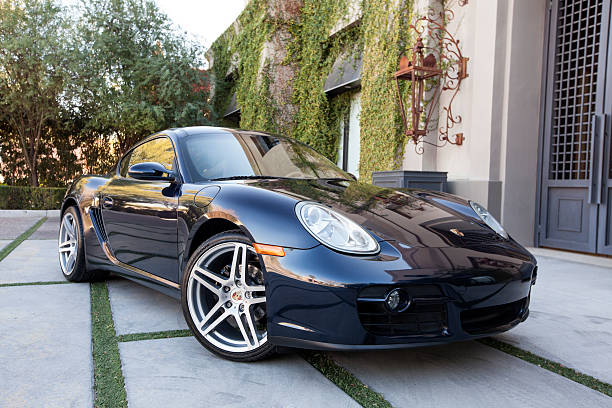 Porsche Cayman 2007 Scottsdale, United States - January 25, 2012: A parked blue 2007 Porsche Cayman, the Cayman features a 6 cylinder mid-engine design. caiman stock pictures, royalty-free photos & images