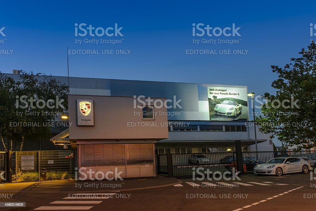 Porsche company headquarters gate car factory Germany night stock photo