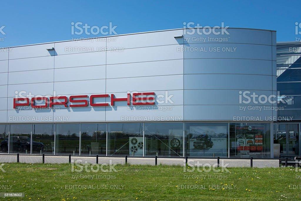 Porsche dealership building with the Porsche sign stock photo