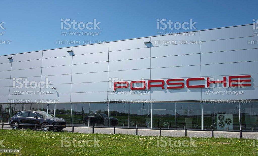 Porsche dealership with a Porsche Macan SUV stock photo