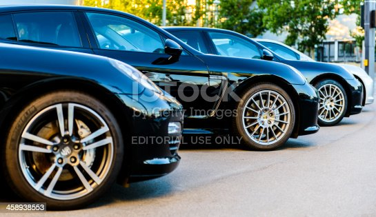 910009838istockphoto Porsche Panamera row black sports wheel front side view 458938553