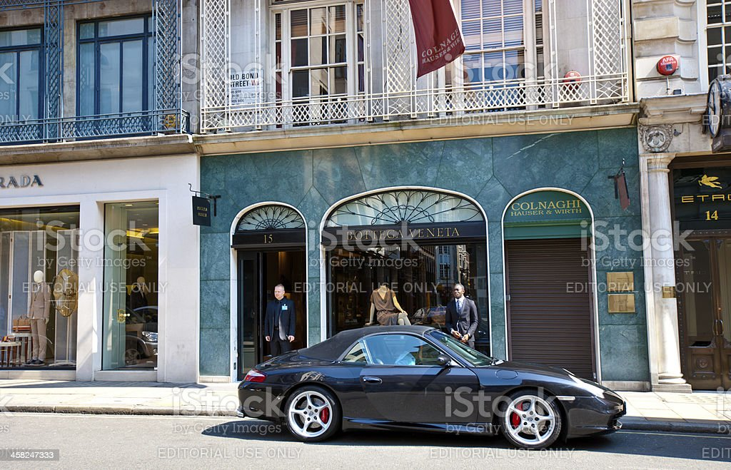 Porsche parked near Bottega Veneta store, London, UK stock photo