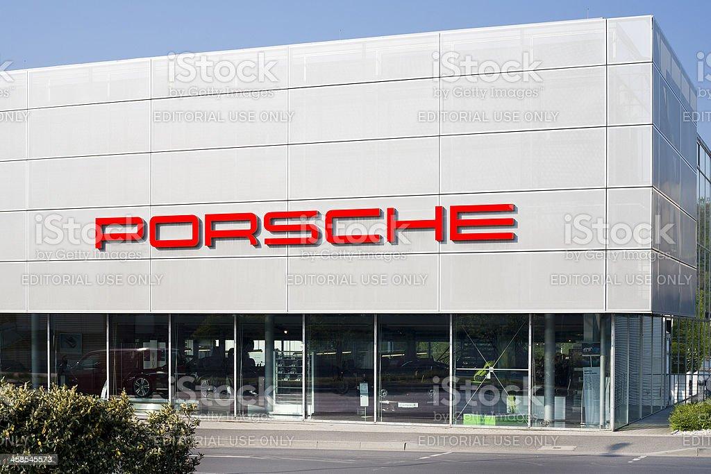 Porsche sign on car dealers facade stock photo