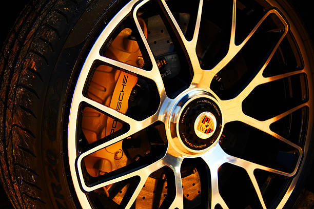 Porsche tyre Marbella, Spain - December 14, 2013: This image shows the details of a tyre, of a luxury Porsche sports car, parked in the Mabella Marina porsche stock pictures, royalty-free photos & images