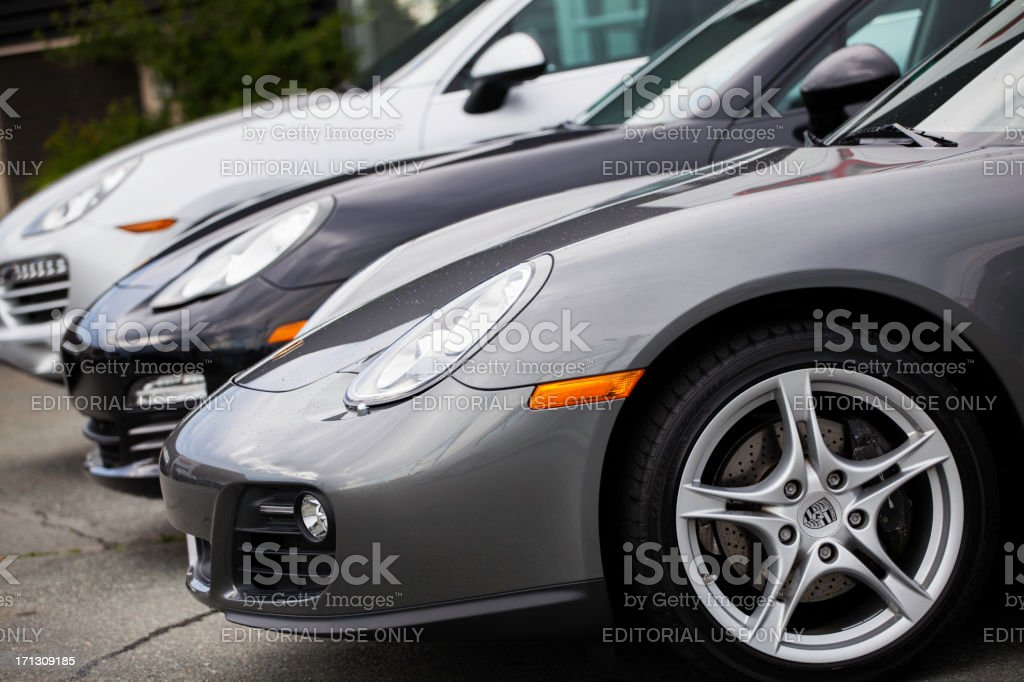 Porsche Vehicles at a Car Dealership stock photo