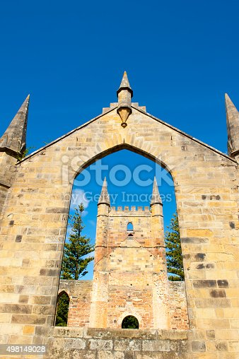 World Heritage Site of  Port Arthur Convict Museum Settlement in Tasmania, Australia, with ruins of historic church building, tourist attraction, blue sky.