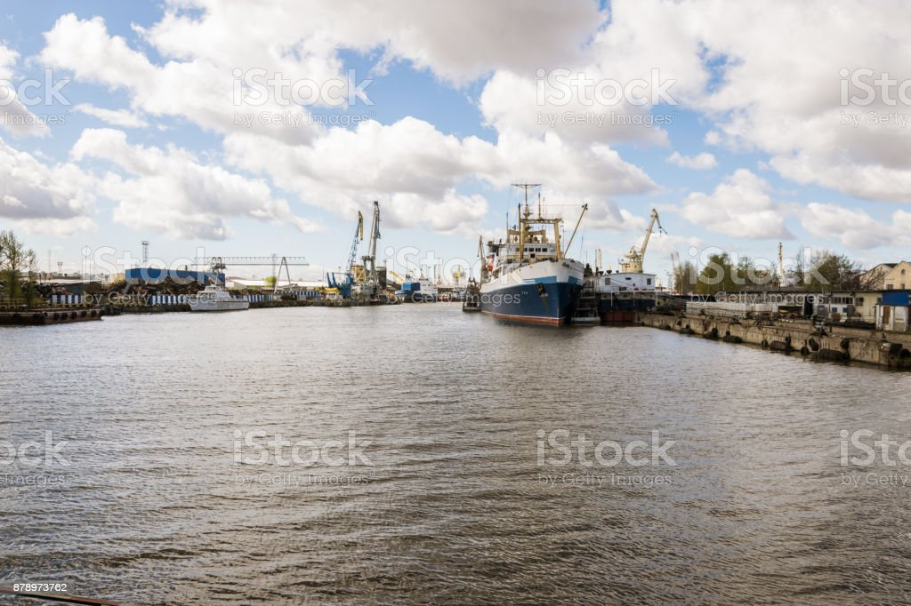 Port, barge and embankment of Kaliningrad with ships. stock photo