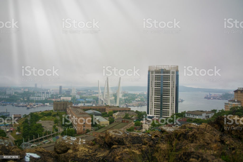 port city view from the heights, high Bay braced bridge, thick fog. Marine City stock photo