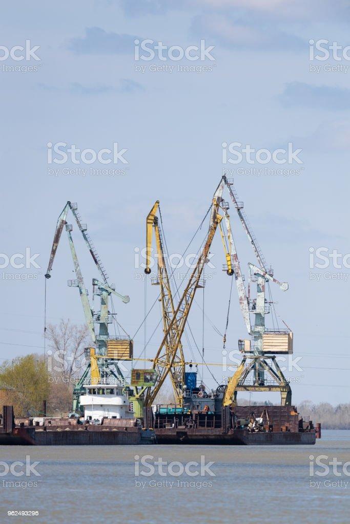 Port crane work - Royalty-free Blue Stock Photo