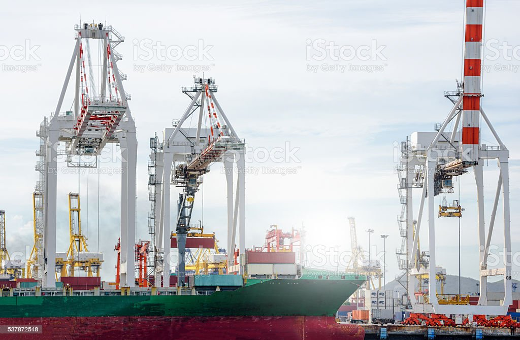 Port cranes working in sea port, Crane of freight dock, stock photo