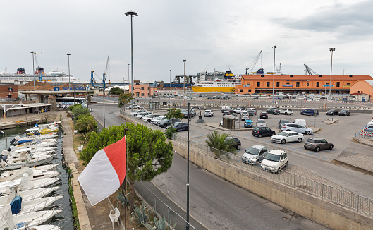 LIVORNO, ITALY - JULY 11, 2019: Cityscape with port Fortress Gate and boats moored in front of the Old Fortress. Livorno is a city on the Ligurian Sea with one of the largest mediterranean seaports.