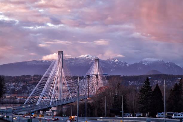 port mann bridge at sunset, bc, canada - british columbia stock photos and pictures