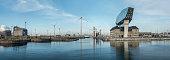 Antwerp, Belgium - 17 November 2019: Port of Antwerp panorama with view on the modern Port House by Zaha Hadid