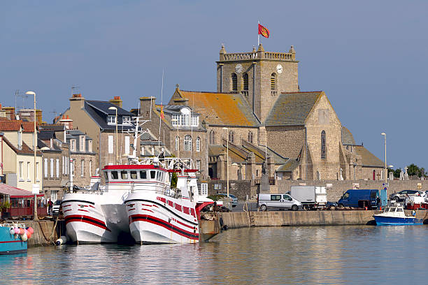 Port of Barfleur in France Port and church of Saint-Nicolas of Barfleur, a commune in the peninsula of Cotentin in the Manche department in Lower Normandy in north-western France manche stock pictures, royalty-free photos & images