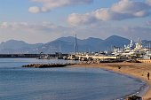 Cannes, France - January 2 2020: Beach view and yachts in Old Port Of Cannes