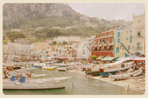 Retro-styled postcard of the Capri waterfront - a popular tourist destination on the Amalfi Coast. All logos and signage have been removed.