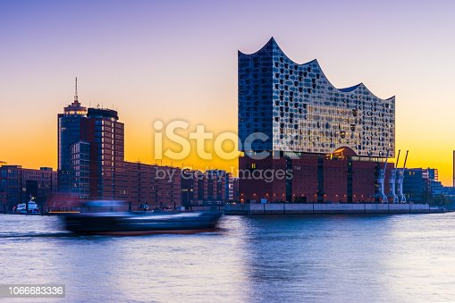 View over the Elbe river in Hamburg germany. Port of Hamburg in the morning with some of the famous landmarks in the background.