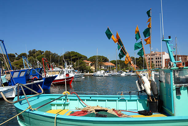 Port of Hyeres Port of Hyeres with a boat in the foreground var stock pictures, royalty-free photos & images