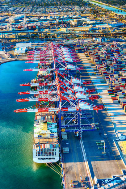 Port of Long Beach Aerial Cargo ships, containers, and cranes in one of the largest ports in the western United States, the Port of Long Beach located i just west of downtown Los Angeles, California and adjacent to San Pedro and the Port of Los Angeles.  This image was shot from an altitude of about 1000 feet. long beach california stock pictures, royalty-free photos & images