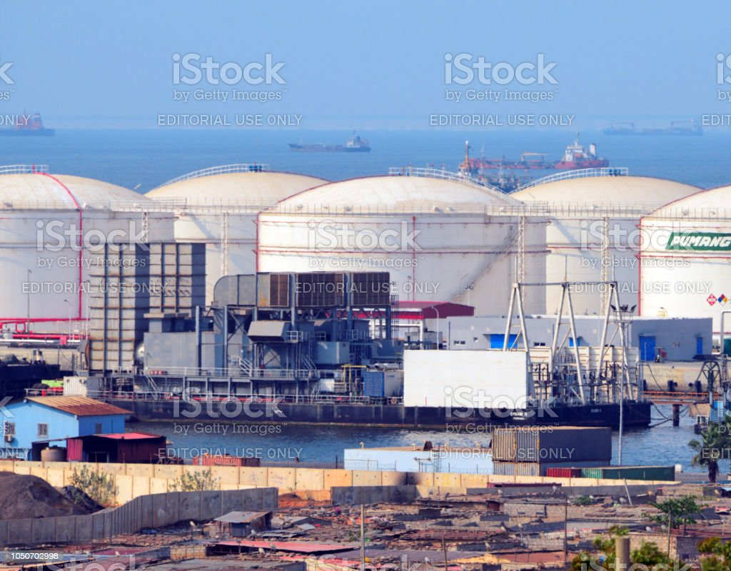 Port of Luanda - power barge Dynamii II (96 MW) in front of the Pumangol oil depot (fuel farm), Angola stock photo