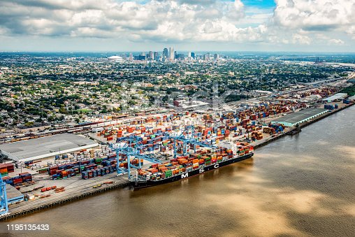 New Orleans, United States - September 28, 2018:  A ship unloading cargo at the Port of New Orleans with the city's skyline in the distance.