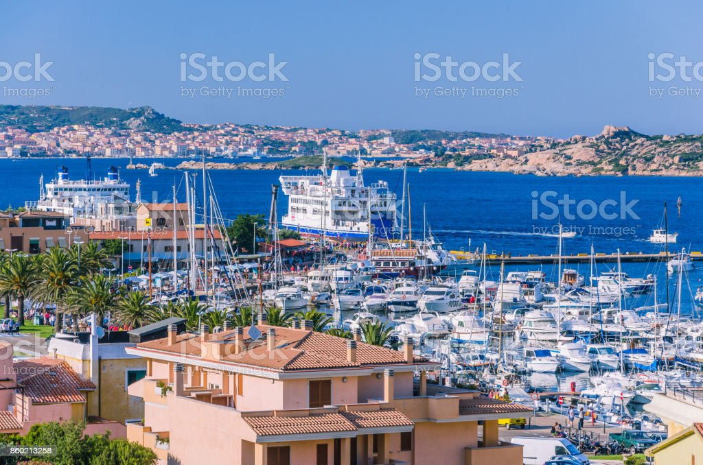 Port of Palau on sardinia island with farry and yacht boats. La Maddalena island in background stock photo