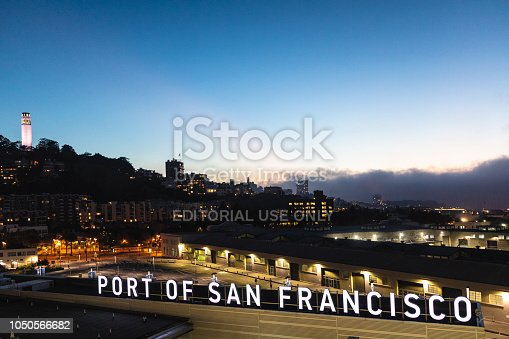 Port of San Francisco and Coit Tower at dusk.