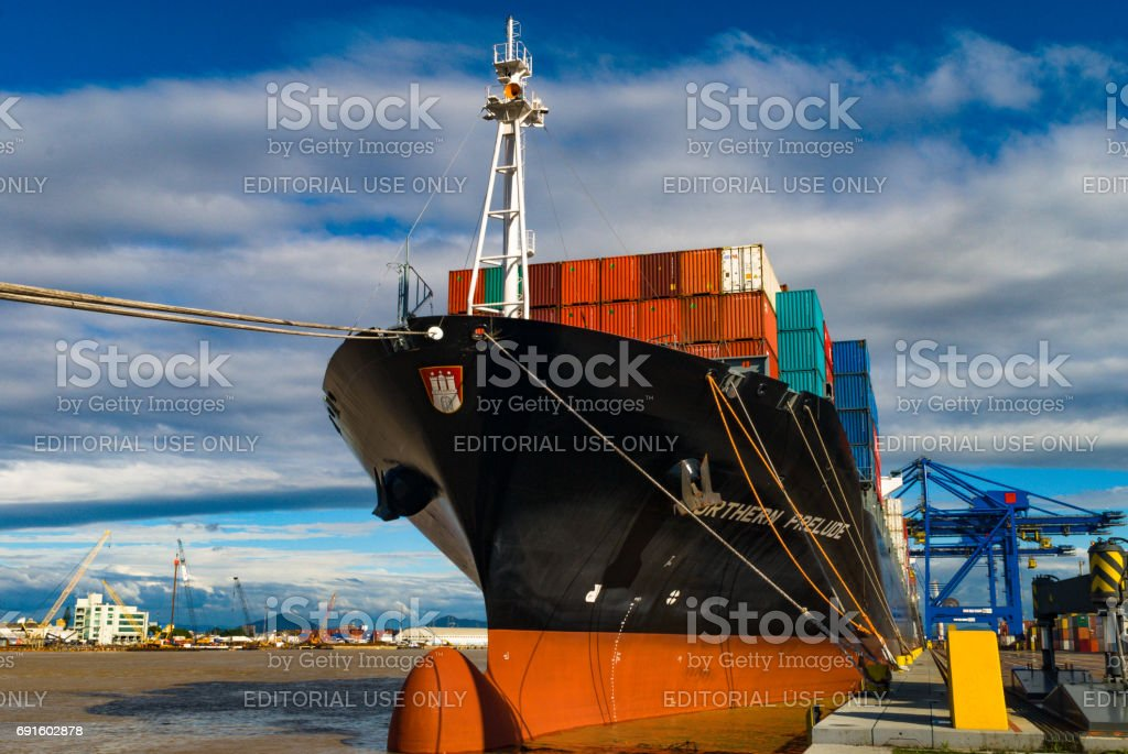 Port of the City of Navegantes - Ship anchored being loaded with containers stock photo