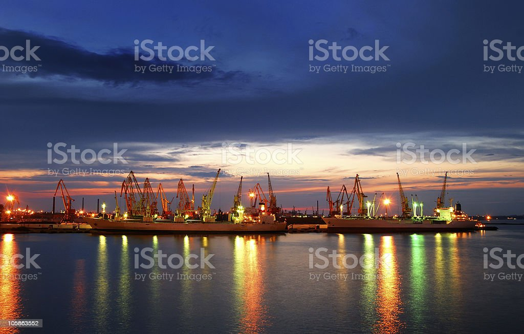 Port with Cato ships and containers illuminated at night royalty-free stock photo