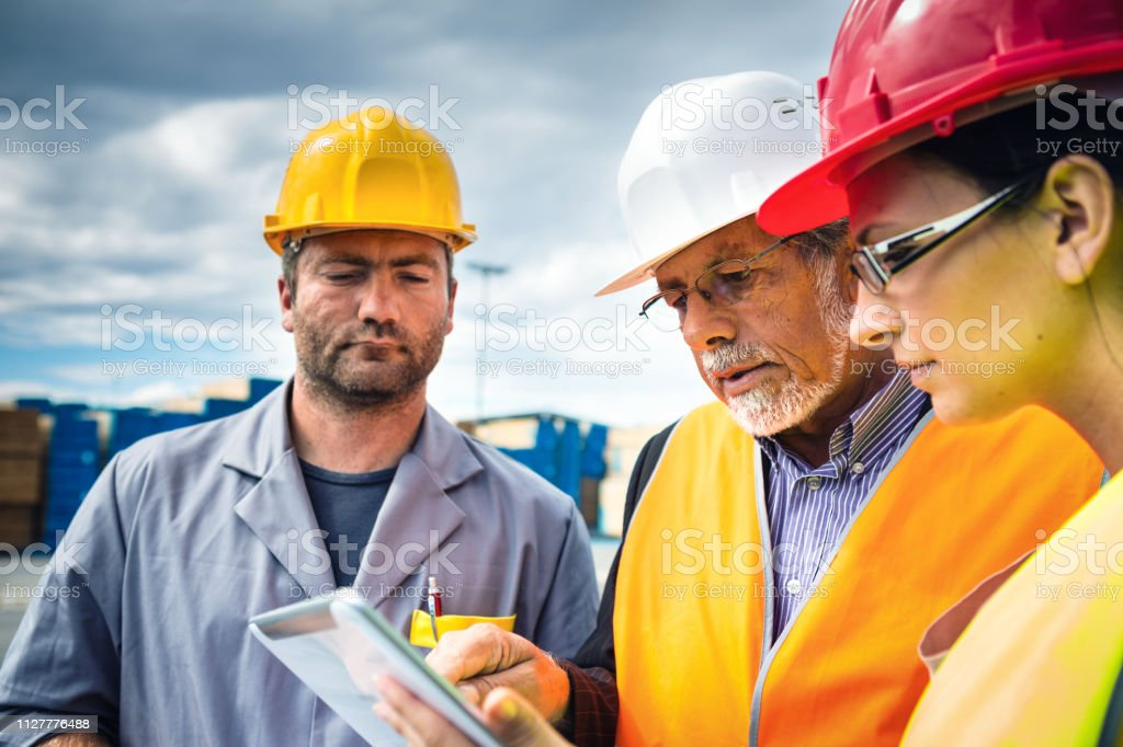 Port Workers Checking Cargo Containers stock photo
