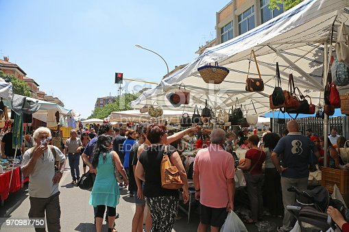 ROME, ITALY - JUNE 29, 2014: People Browsing For Cheap Bags and Clothing at Porta Portese Sunday Flea Market in Rome, Italy.