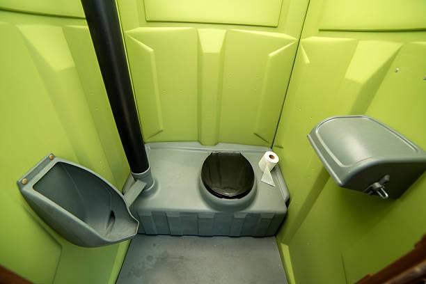 Porta Potty Kalispell, MT, USA - July 1st, 2015: Porta Potty inside, Montana USA.  portable toilet stock pictures, royalty-free photos & images