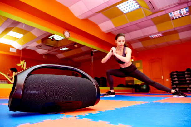 Portable acoustics in the aerobics room on the background of a blurred girl practicing sport. stock photo