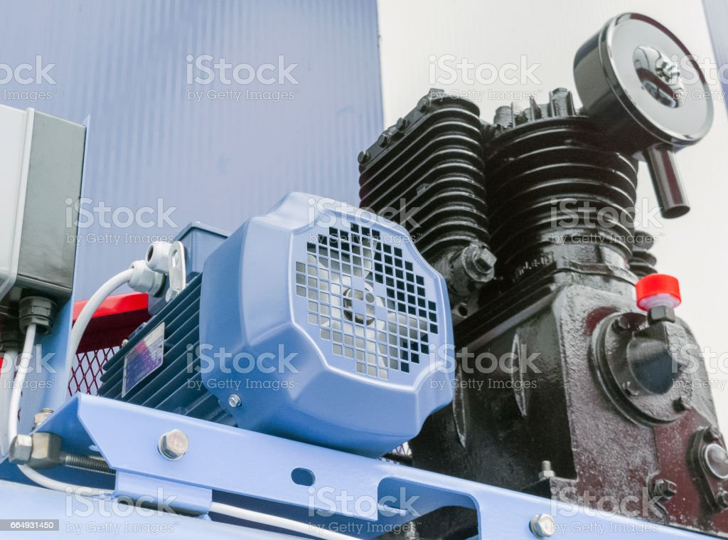 Portable air electric compressor. Cropped image. stock photo
